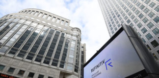 © Reuters. The Refinitiv logo is seen on a large screen in Canary Wharf in London