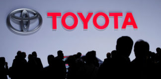 © Reuters. FILE PHOTO: A Toyota logo is displayed at the 89th Geneva International Motor Show