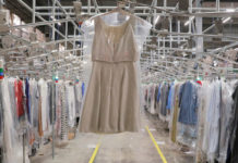 © Reuters. A garment hangs in the automated sortation section at Rent the Runway